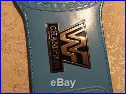 WWF-WWE winged eagle championship belt on blue strap Like Ultimate Warrior held