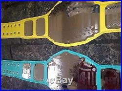 World Championship Belt Continental Championship Belt Teal Yellow 2 belts wwe